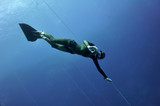 Freediver shows the OK sign