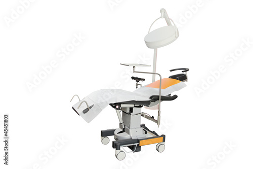 The image of dental chair under the white background