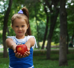 little cute girl stretching apple