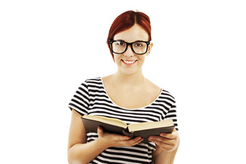 Redhead woman with glasses reading a book on white background
