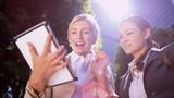 Businesswomen using wireless tablet