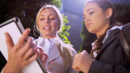 Businesswomen using wireless tablet