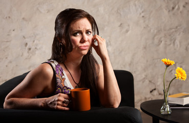 Worried Woman with Cup