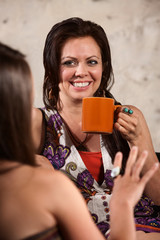 Smiling Woman Drinking Coffee with Friend
