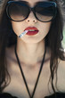beautiful brunette with glasses smoking