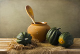 Still life with acorn squash on wooden tabletop poster