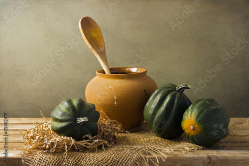 Still life with acorn squash on wooden tabletop