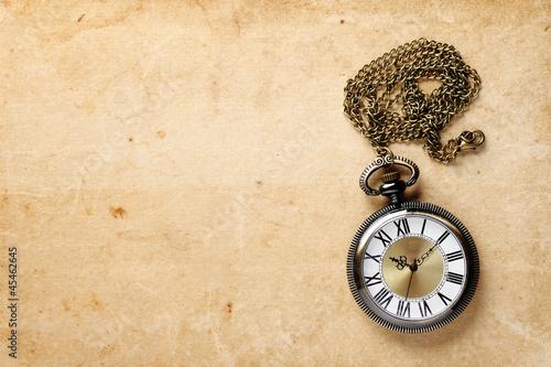 Vintage pocket watch on old paper - 45462645