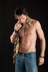 Portrait of confident young man shirtless with jeans