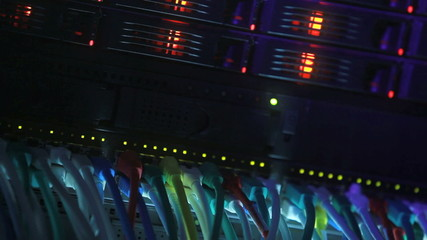 Server Rack and Network Hub cables with flickering lights