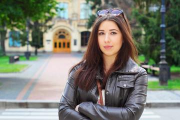 Pretty brunette girl in front of Institute in Kiev, Ukraine