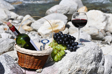 Red wine and grapes served at a picnic. Verzasca valley, Switzer