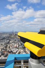 Binoculars overlooking panorama of Paris