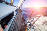 Fototapety Sailing regatta in the sunset light
