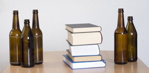 Books and beer bottles on the table