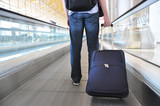 Traveler with a bag at the speedwalk . poster