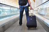 Traveller with a suitcase on the speedwalk poster