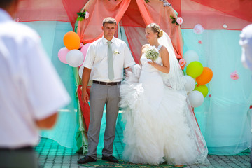 Bride and groom during newlyweds wedding ceremony