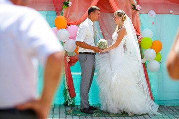 Bride and groom newlyweds are on register ceremony content and c