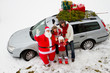 Christmas - family with Christmas tree and gifts on the car