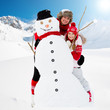 Winter fun, snowman and happy family