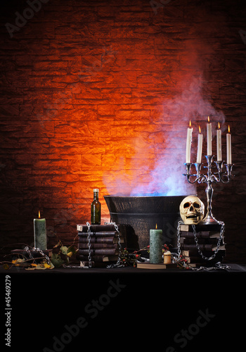 A Halloween composition of candles, sorcery and a skull