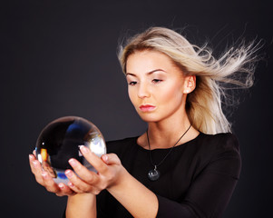 Young woman with crystal ball.