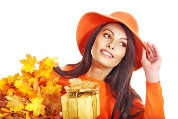 Woman holding autumn gift box .