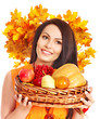 Woman holding autumn basket.
