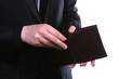 Businessman well-dressed looking for money in the wallet