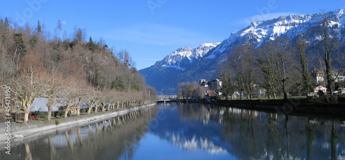 View to Aare river and snowy Alps. Interlaken, Switzerland