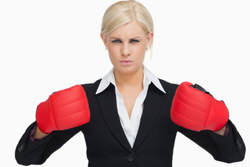Serious businesswoman wearing red gloves