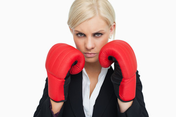 Combative woman with red gloves fighting