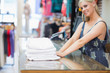 Woman standing behind the counter of the shop