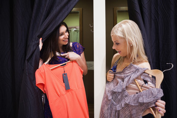Women standing in a changing room talking