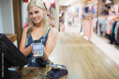 Woman holding credit card machine