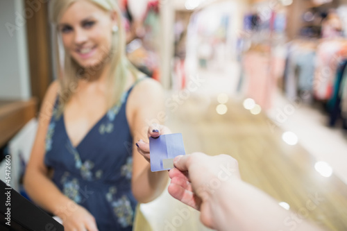 Woman being handed credit card