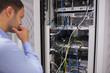 Man looking at rack mounted servers