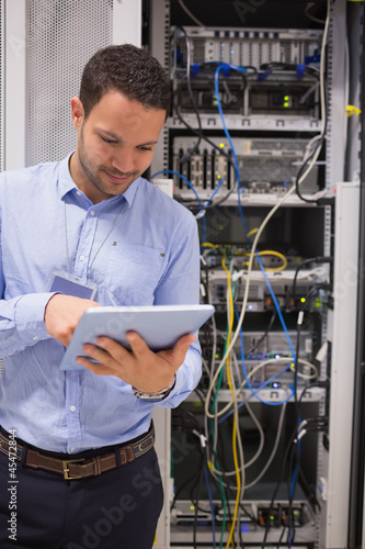 Man in data centre with tablet pc