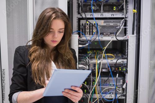 Deurstickers Woman using tablet pc in front of servers