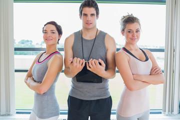 Trainer standing between two women