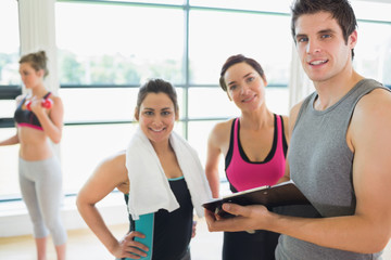 Trainer and women smiling