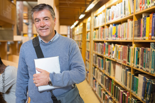 Man holding a book to his chest