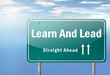"Highway Signpost ""Learn And Lead"""