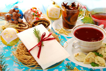 christmas eve table with wafer and traditional dishes