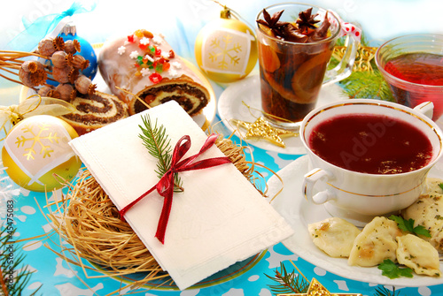 christmas eve table with wafer and traditional dishes - 45475083