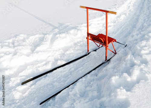 Finnish sleigh with red wooden chair and metal construction