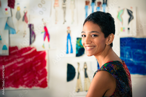 Portrait of happy hispanic young woman working as fashion design - 45476264