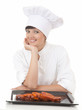 happy chef woman with raw meat, white background