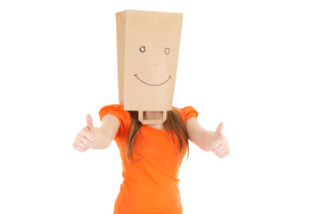 girl in smiling paper bag on head with thumbs up